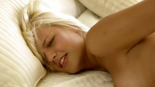 Astounding blonde lying on the bed and masturbating her cunt